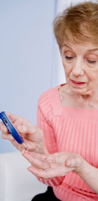 Picture of Woman Testing Blood Sugar Levels